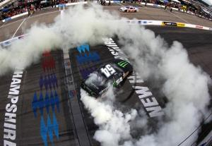 Kyle Busch, driver of the #54 Monster Energy Toyota, celebrates winning the NASCAR Nationwide Series CNBC Prime's The Profit 200 at New Hampshire Motor Speedway on July 13, 2013  Photo - Jonathan Ferrey/Getty Images