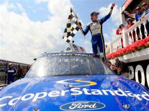 Ryan Blaney , driver of the #29 Cooper Standard Ford , celebrates in Victory Lane after winning the NASCAR Camping World Truck Series Pocono Mountains 125 at Pocono Raceway on August 3, 2013  Photo - Geoff Burke/Getty Images