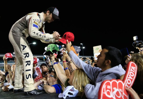 Daniel Suarez, driver of the #19 ARRIS Toyota, signs autographs for fans in Victory Lane after winning the NASCAR XFINITY Series Ford EcoBoost 300 and the NASCAR XFINITY Series Championship at Homestead-Miami Speedway on November 19, 2016 in Homestead, Florida. Photo - Chris Trotman/Getty Images
