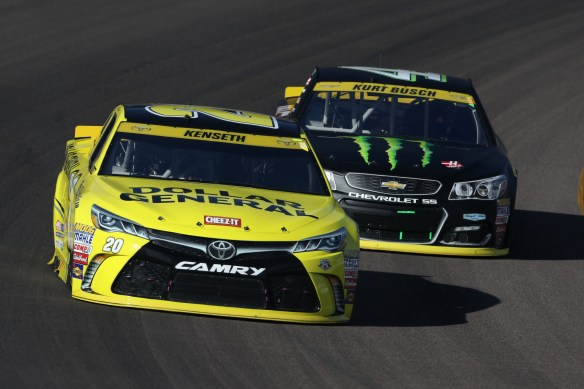 AVONDALE, AZ - NOVEMBER 13: Matt Kenseth, driver of the #20 Dollar General Toyota, leads Kurt Busch, driver of the #41 Monster Energy/Haas Automation Chevrolet, during the NASCAR Sprint Cup Series Can-Am 500 at Phoenix International Raceway on November 13, 2016 in Avondale, Arizona. Photo by Christian Petersen/Getty Images