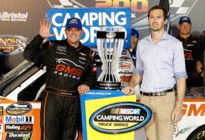 Johnny Sauter, driver of the #21 GMS Fabrication Chevrolet, celebrates with the trophy in Victory Lane after winning the NASCAR Camping World Truck Series UHOH 200 at Bristol Motor Speedway on August 16, 2018 in Bristol, Tennessee. Photo - Brian Lawdermilk/Getty Images