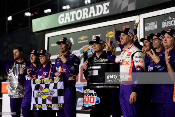 Denny Hamlin and his No. 11 Joe Gibbs Racing Team celebrate his second Daytona 500 win in victory lane at Daytona International Speedway.