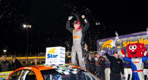 Sam Mayer celebrates in victory lane after winning season opener for ARCA Menards Series West