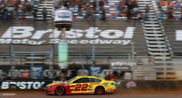 Joey Logano earns a historic NASCAR victory in the Food City Dirt Race at Bristol Motor Speedway on Monday after a rain-delay on Sunday.