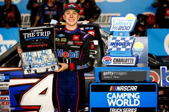 John Hunter Nemechek holds off Carson Hocevar for a Charlotte victory in the NASCAR Truck Series North Carolina Lottery 200 on Friday night.