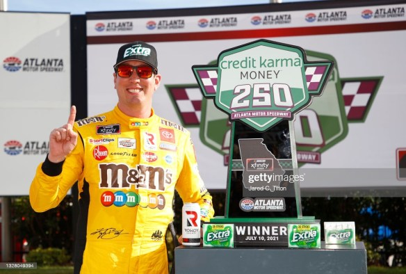Kyle Busch earns historic NASCAR Xfinity Series victory in an overtime thrillerin the Credit Karma Money 250 at Atlanta Motor Speedway.