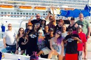 The GLOW GIrls and several Superfans getting on the catamaran.