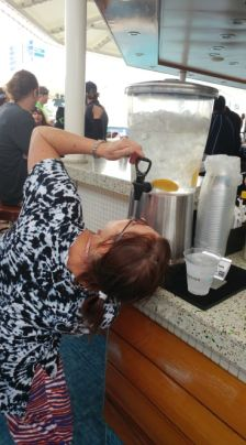 Angel rehydrating on the AfterGLOW Pub Crawl. Photo by Adrian Duarte.