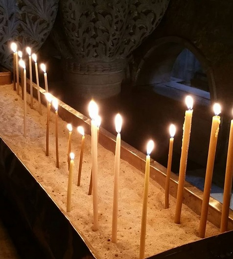 Lit candles at Golgotha in the Church of the Holy Sepluchre, Jerusalem.