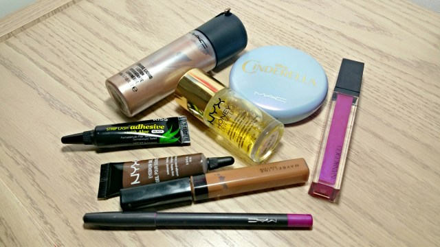 MAC Golden Elixir Strobe Liquid, Kiss Strip Lash Adhesive with Aloe, NYX Espresso Eyebrow Gel, Maybelline Fit Me Concealer 30, MAC Fashion Boost Lip Pencil, NYX Honey Dew Me Up Primer Serum, MAC Coupe D'Chic Iridescent Powder, Nanacoco Uptown GIrl Lipgloss