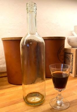 Old wine in clear bottle