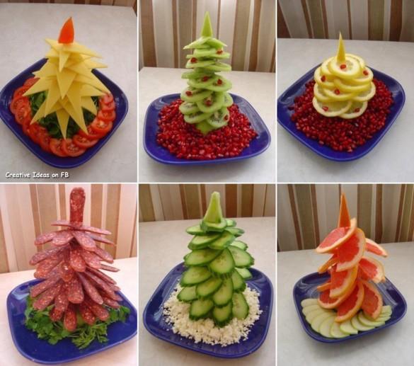 Christmas tree plates arrangement from cheese, kiwi, lemon, salami, cucumber, red orange