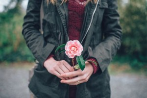 Girl-Holding-Pink-Flower