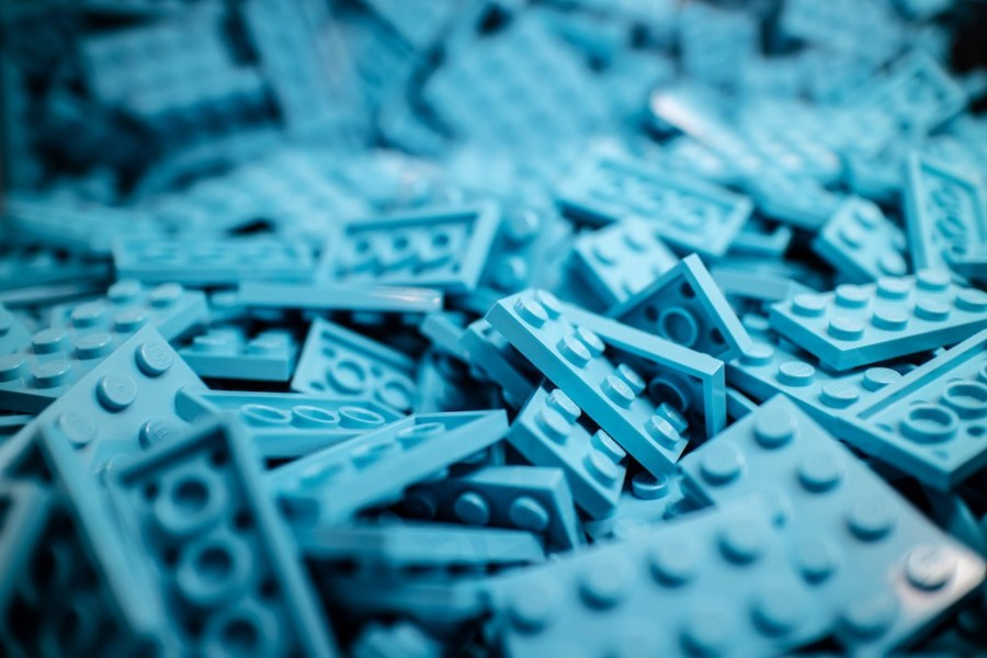 Small-Lego-pieces-scattered-across-the-room-floor