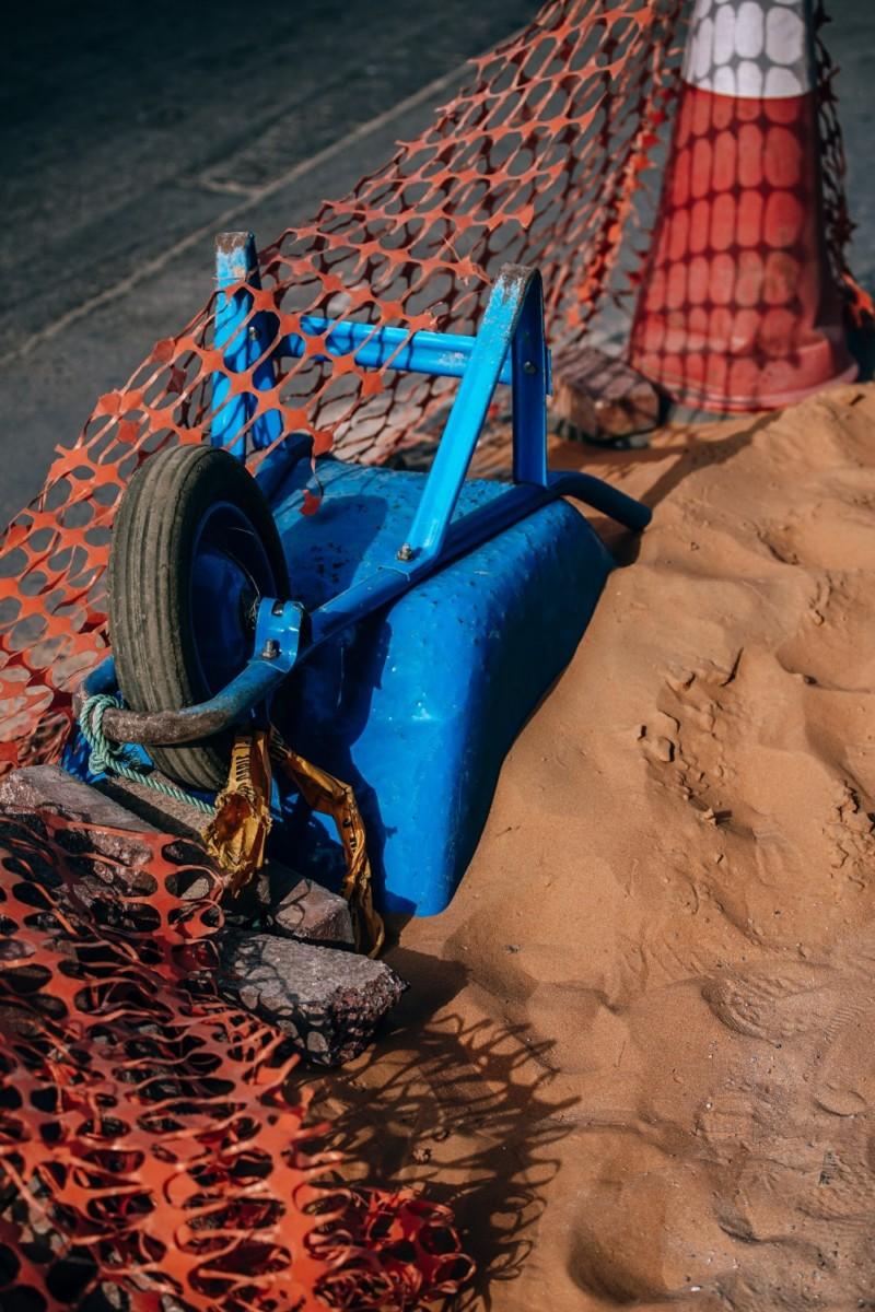 Blue-Wheelbarrow-Flipped-Over-at-a-Construction-Zone