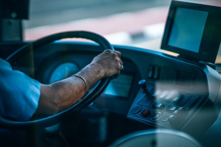 Bus-Driver-with-a-Gold-Bracelet-Holding-the-Steering-Wheel