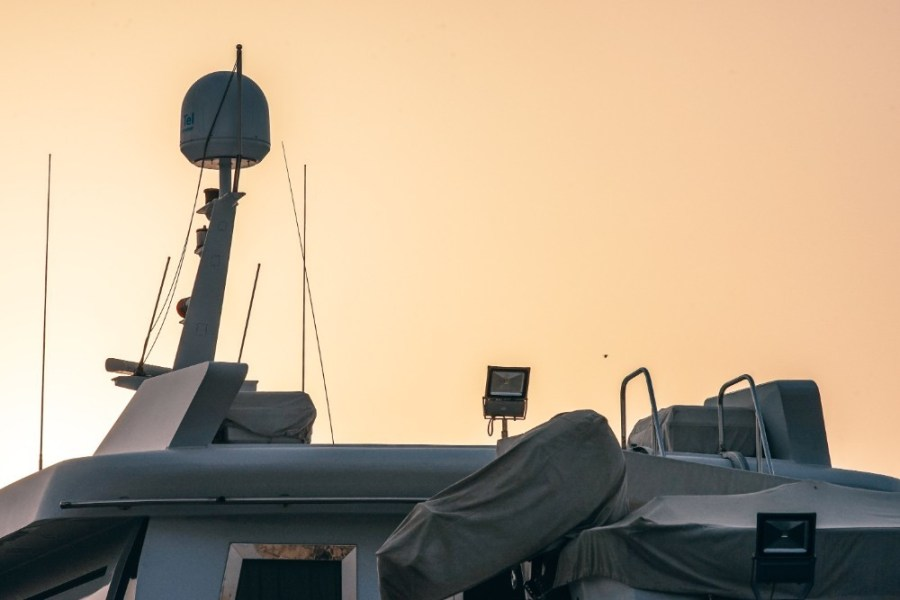 Satellite-Navigation-on-a-Boat-with-the-Yellow-Sky-in-the-Background