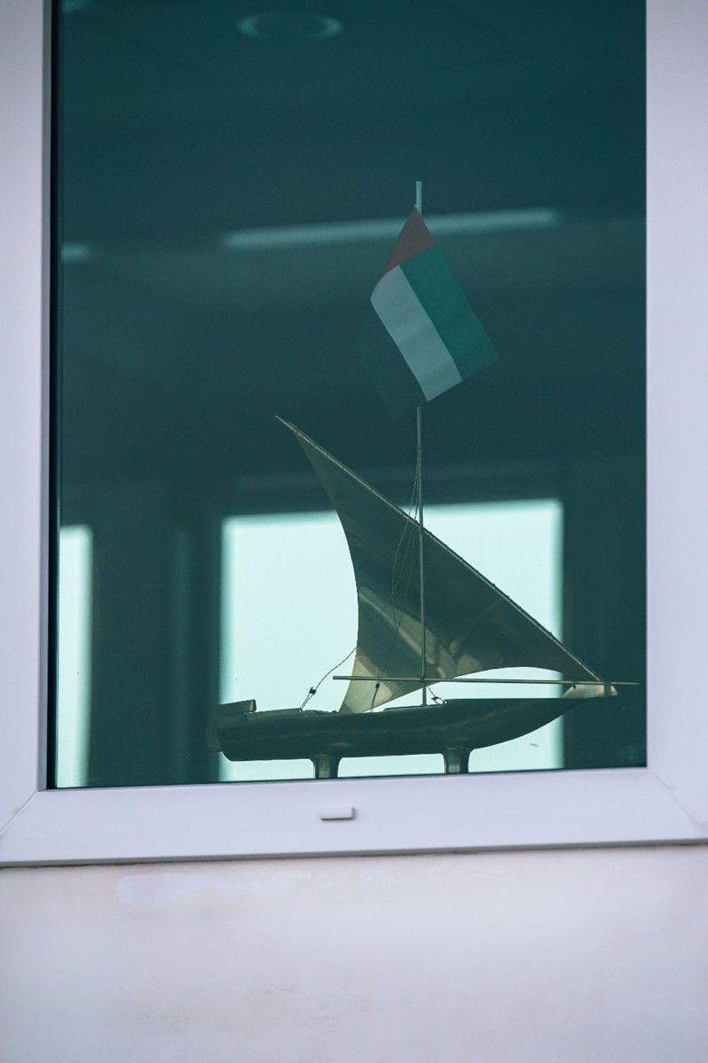 Small-Display-Boat-in-a-Window-with-the-UAE-Flag-on-it
