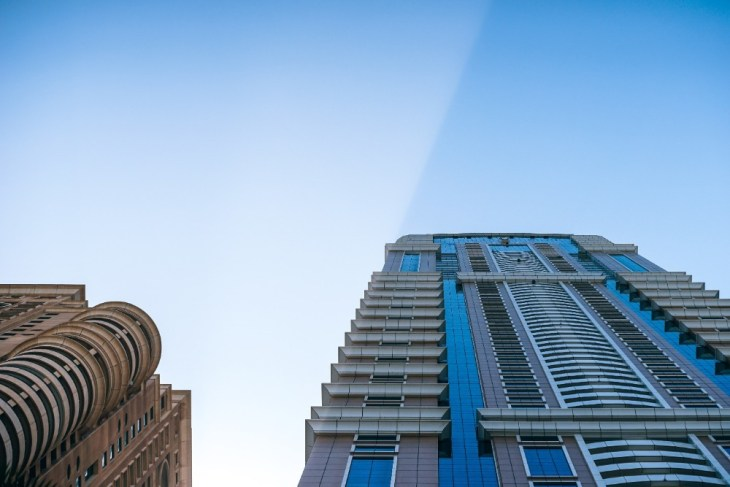 Sunrise-in-Dubai-Photographed-from-Below-with-Two-Tall-Buildings