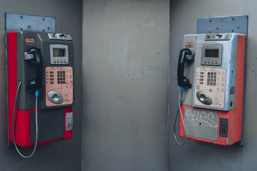Two-Vintage-Pay-Phones-Attached-on-a-Wall
