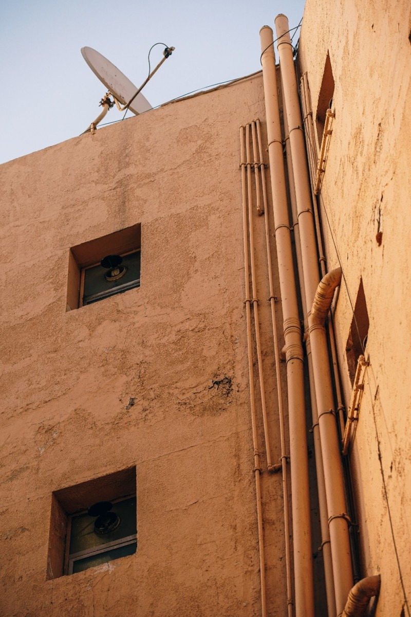 Yellow-Building-in-Old-Dubai-with-Two-Windows