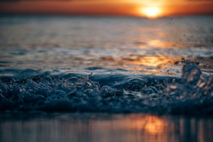 Amazing-Wave-Splash-with-a-Beautiful-Sunset-in-the-Background