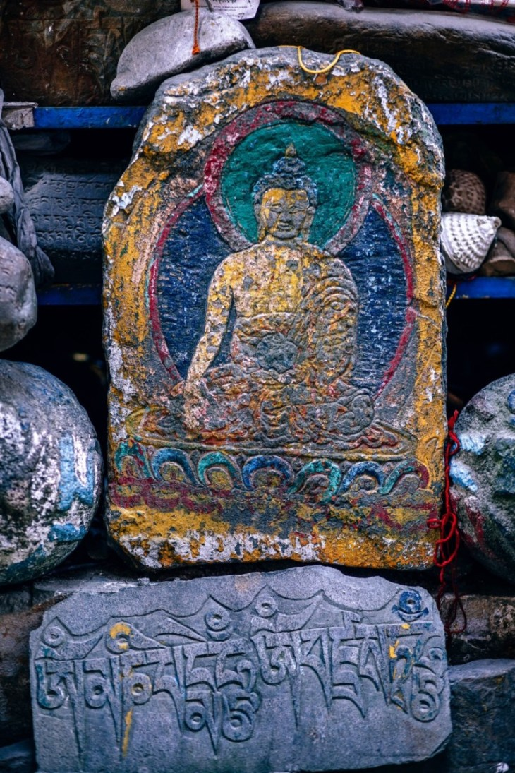 Colorful-Buddha-Carving-on-a-Stone