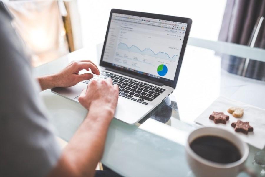 Man-using-his-laptop-to-check-google-analytics
