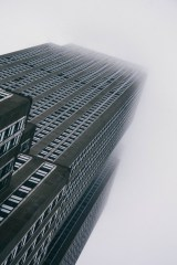 Tall-New-York-City-Skyscraper-Disappearing-in-Fog