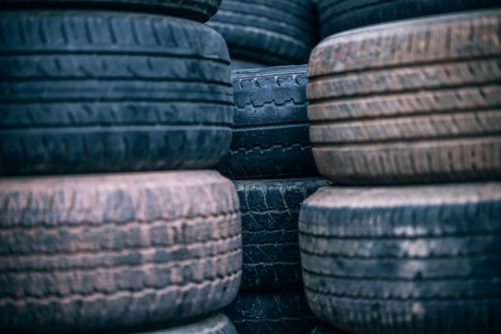 Used-Car-Tires-Stacked-on-top-of-each-other