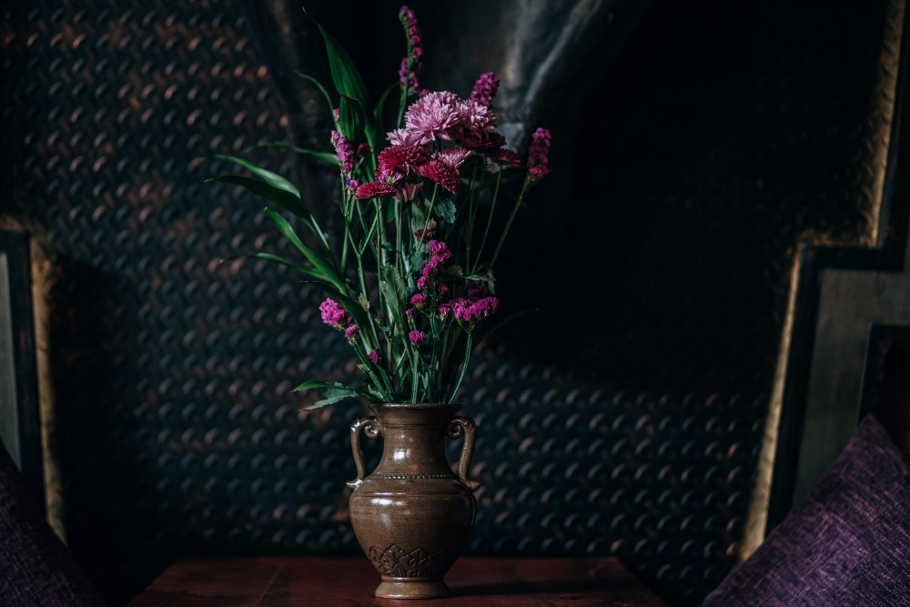 Vase Full of Pink Flowers Placed in front of a Black Wall & Close-up Shot of Dried Flowers inside a Dark Vase | Fancycrave