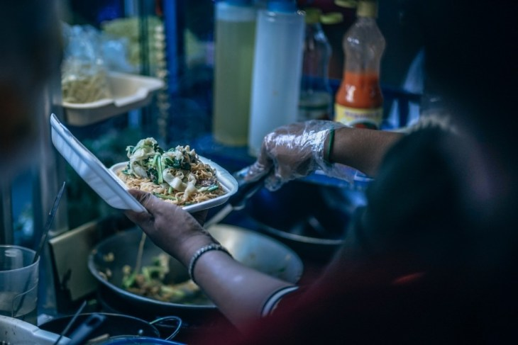 Woman-Preparing-Noodles-in-a-Fast-Food-Restaurant