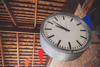Big-Retro-Clock-Attached-on-a-Brick-Wall