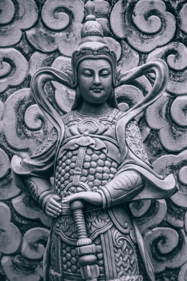 Close-up-Shot-of-a-Buddhist-Warrior-Statue