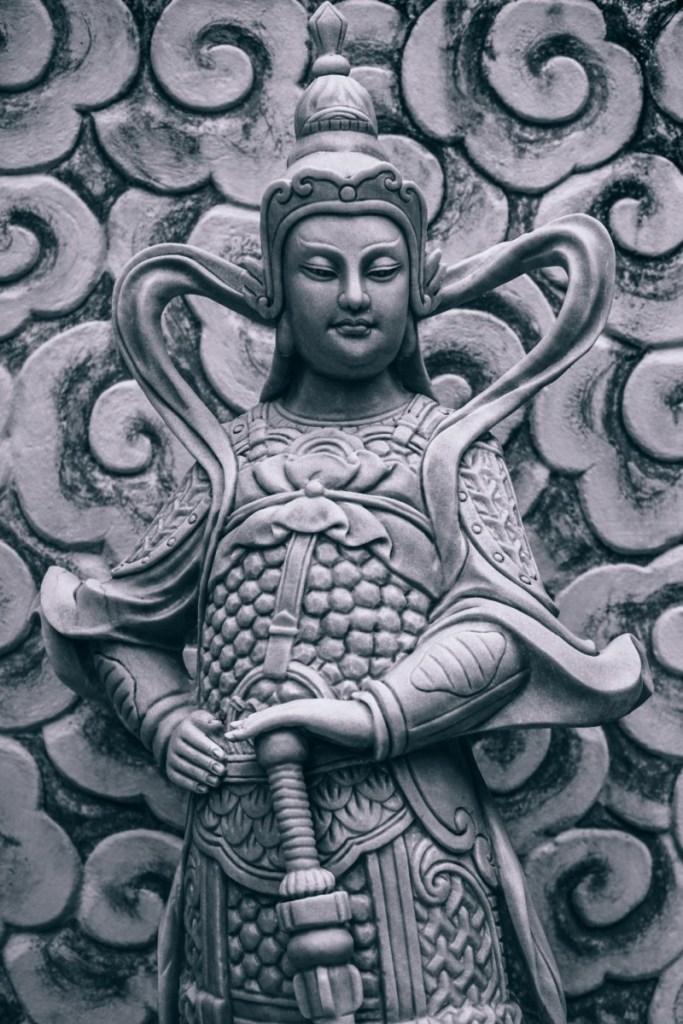 Close-up-Shot-of-a-Buddhist-Warrior-Statue-683x1024
