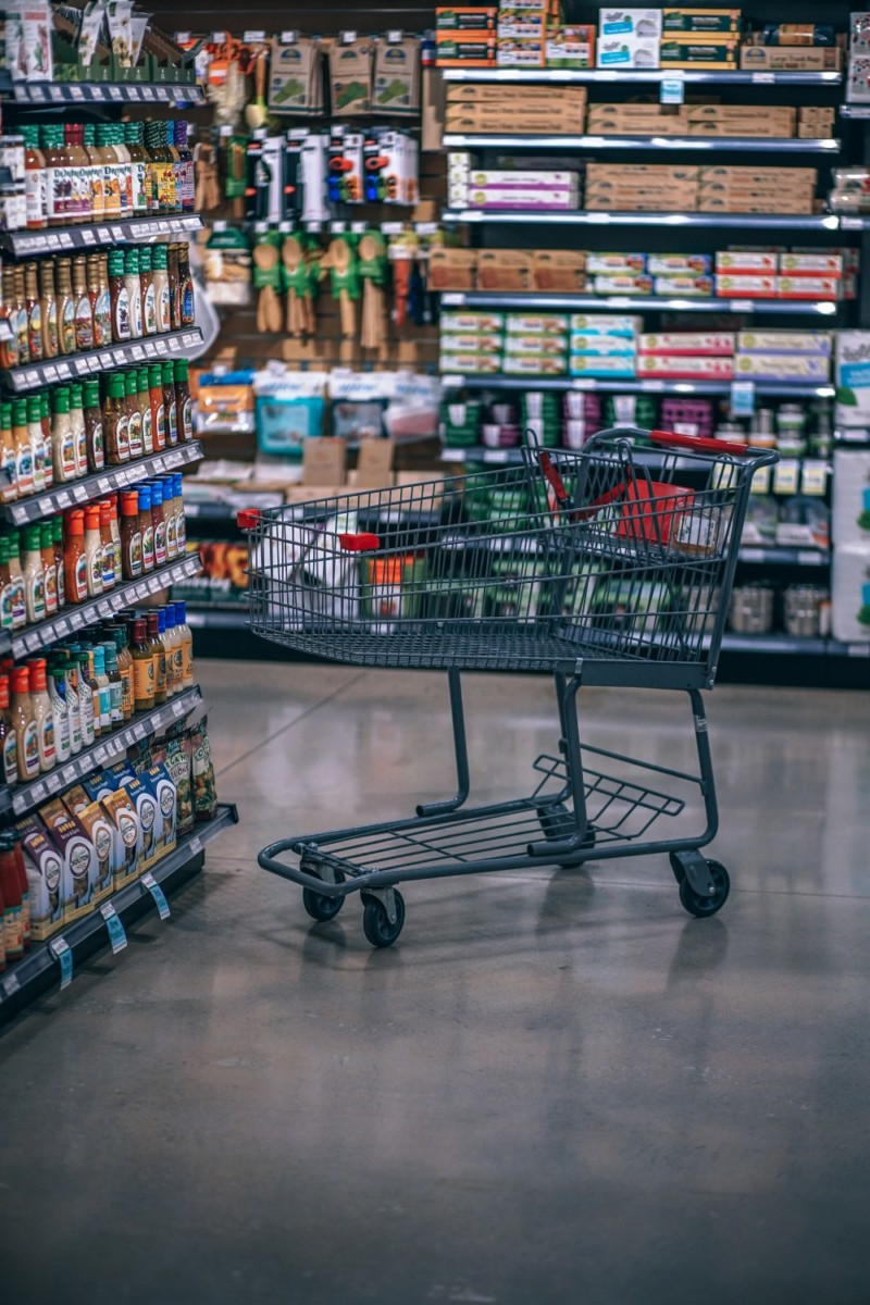 Empty-Grocery-Cart-left-by-the-Shelves-in-an-Organic-Grocery-Store