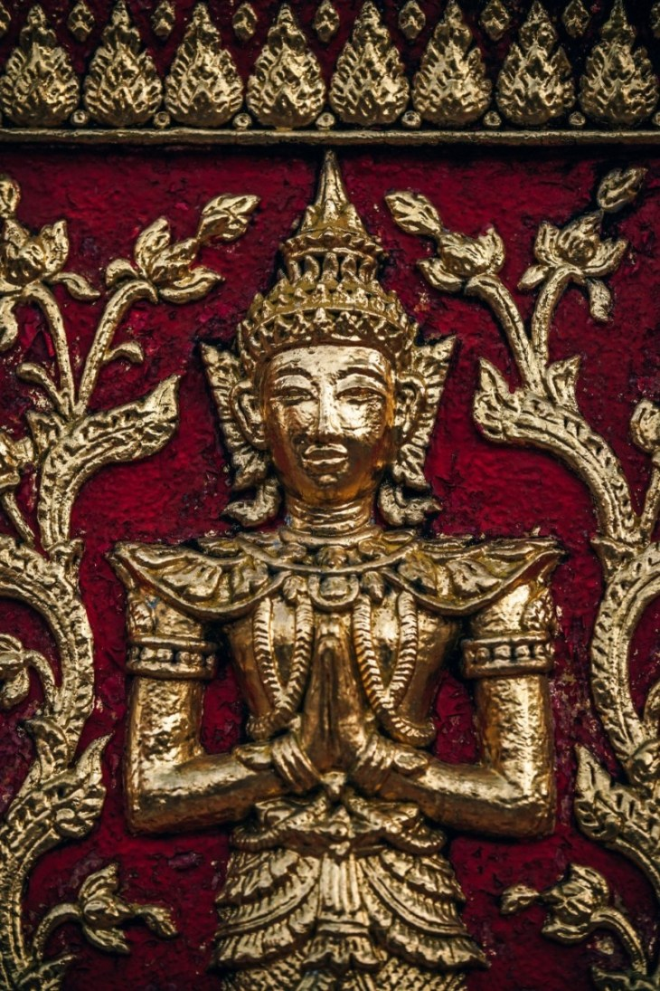 Golden-Statue-on-the-Doi-Suthep-Temple-Wall-in-Chiang-Mai
