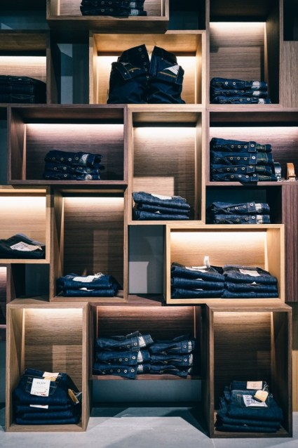 Jeans-Placed-on-Artistic-Shelves-in-a-Clothing-Store