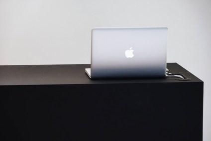 Minimalistic-Store-Register-with-a-MacBook-on-top-of-it