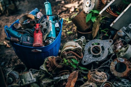 Old-Rusty-Metal-Parts-next-to-a-Plastic-Bucket-full-of-Old-Power-Tools