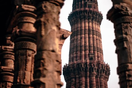 The-Amazing-Qutub-Minar-Seen-Through-the-Pillars-of-a-Jain-Temple