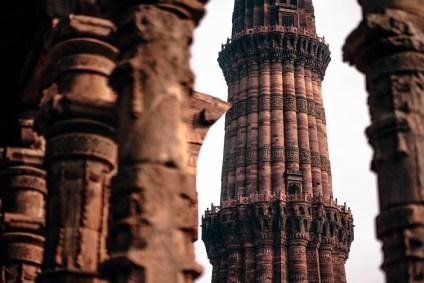 The-Amazing-Qutub-Minar-Seen-Through-the-Pillars-of-a-Jain-Temple