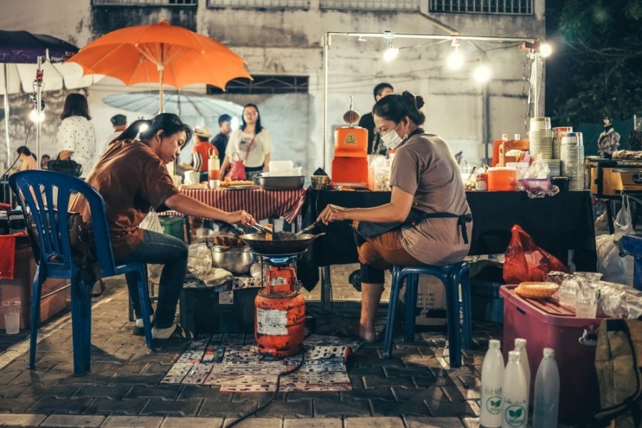 Two-Thai-Women-Frying-Food-over-a-Gas-Tank-at-a-Night-Market