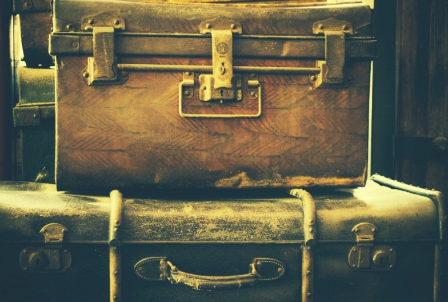 Vintage-Leather-Suitcases-Placed-on-top-of-Each-Other