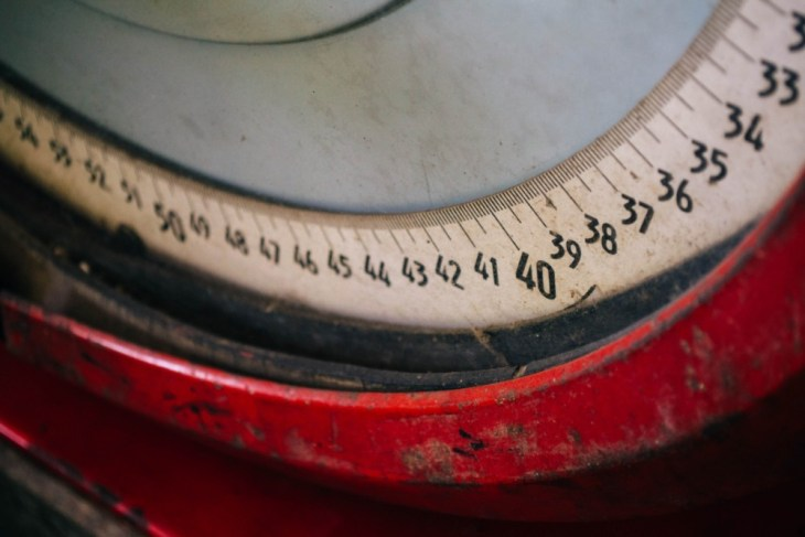 Vintage-Measuring-Scale-with-a-Red-Metal-Frame