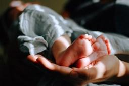 mom-holding-baby-feet