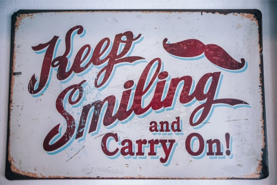"""Café-Sign-Saying-""""Keep-Smiling-and-Carry-On"""""""