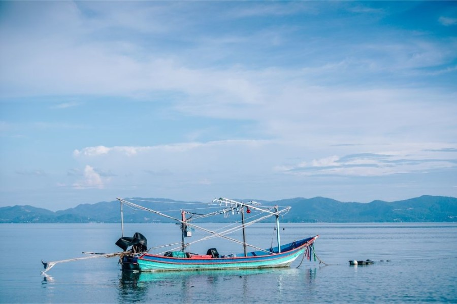 Colorful-Fishing-Boat-with-a-Tropical-Island-in-the-Background