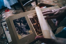 Hands-Flipping-a-Page-on-an-Old-Family-Album