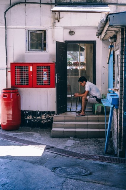 Man-Taking-a-Break-from-Work-and-Looking-at-his-Cell-Phone